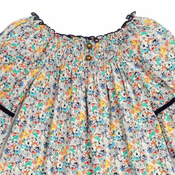 Blouse à col smocks en coton liberty fleuri bleu, jaune et vert, manches bouffantes, col smock de la marque de mode pour enfant LA FAUTE A VOLTAIRE