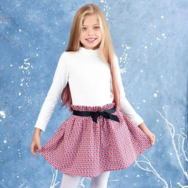 jupe fleurie en coton rose avec taille élastique en satin noir. Pour les petites filles de 2 à 12 ans. Marque Française pour enfant LA FAUTE A VOLTAIRE
