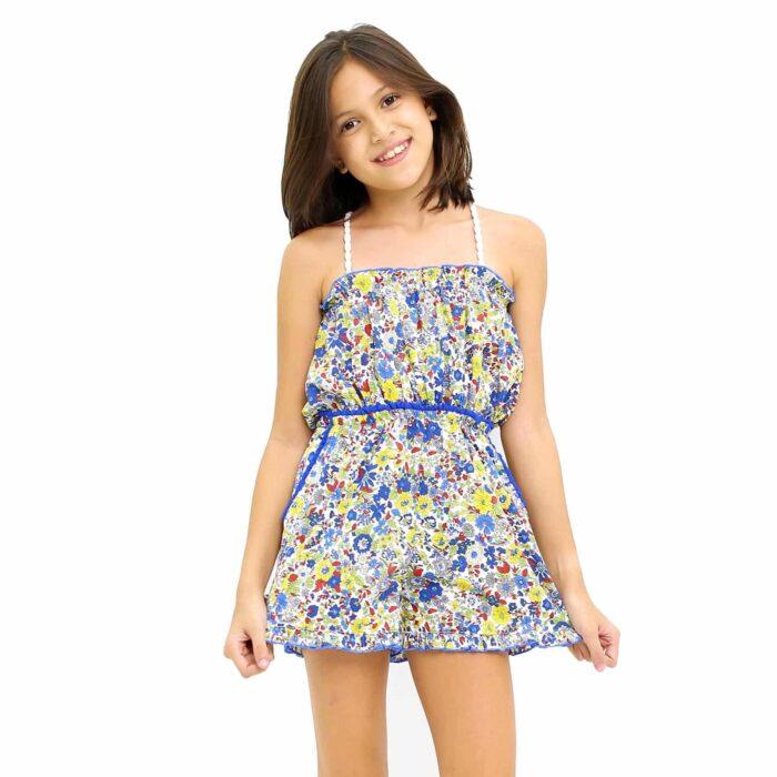 Combishort d'été en coton fleuri liberty jaune et bleu avec poitrine smockée, bretelles pompons blancs et poches pour filles de 2 à 14 ans