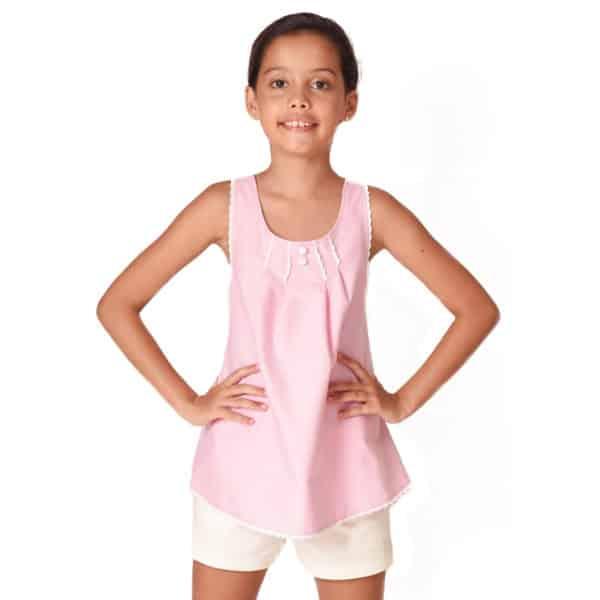 Blouse d'été en coton rose pâle bordé de fine dentelle blanche avec bretelles croisées dans le dos pour filles de 2 à 14 ans