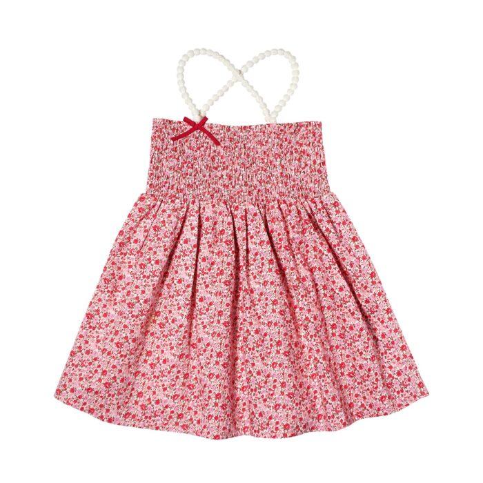 Haut été en coton fleuri liberty rose avec poitrine à smocks et bretelles en pompons blancs pour filles de 2 à 12 ans