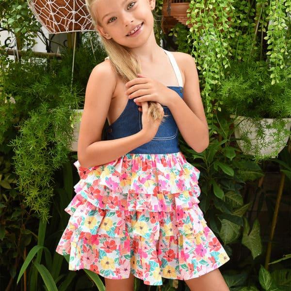 Robe salopette en coton denim bleu foncé avec jupe à volants imprimée fleurs hawaïennes roses et jaunes et bretelles croisées dans le dos pour filles de 2 à 14 ans