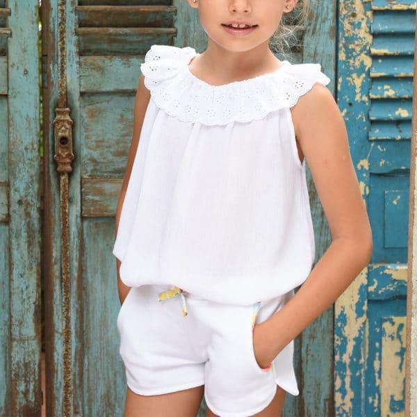 Short en coton molletonné blanc avec taille élastique et poches bordées de coton fleuri multicolore pour filles de 2 à 12 ans