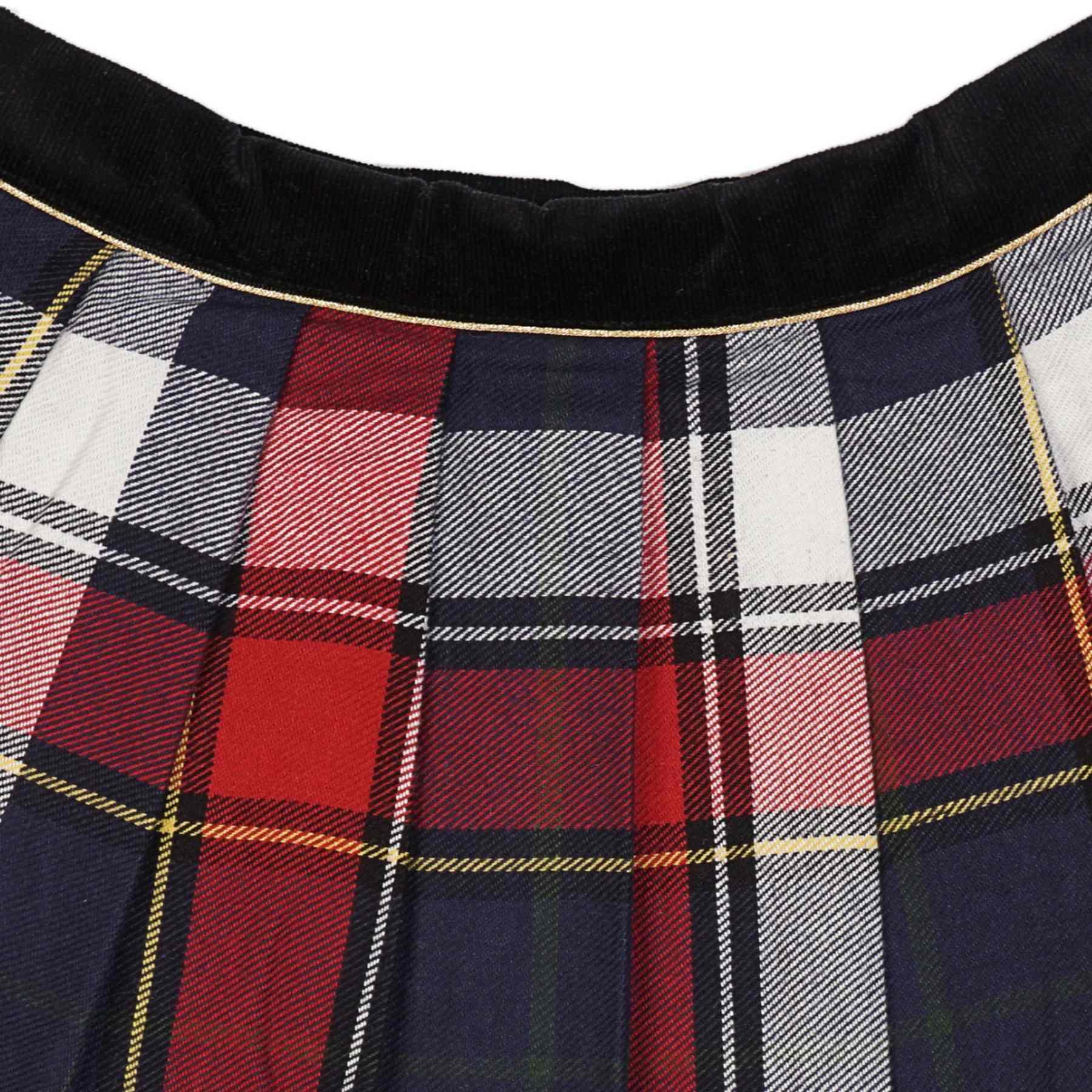 jupe écossaise en laine carreaux tartan bleu marine rouge pour filles et ados de 2 à 16 ans, avec ceinture intégrée en velours noir et biais doré contrasté. Fermeture sur le côté avec bouton pression et fermeture éclair. Marque créateur française de LA FAUTE A VOLTAIRE