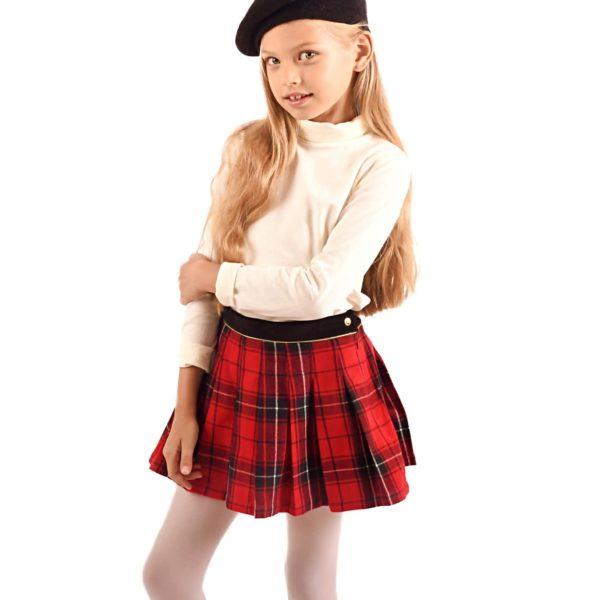 jupe écossaise en laine carreaux tartan rouge pour filles et ados de 2 à 16 ans, avec ceinture intégrée en velours noir et biais doré contrasté. Fermeture sur le côté avec bouton pression et fermeture éclair. Marque créateur française de LA FAUTE A VOLTAIRE