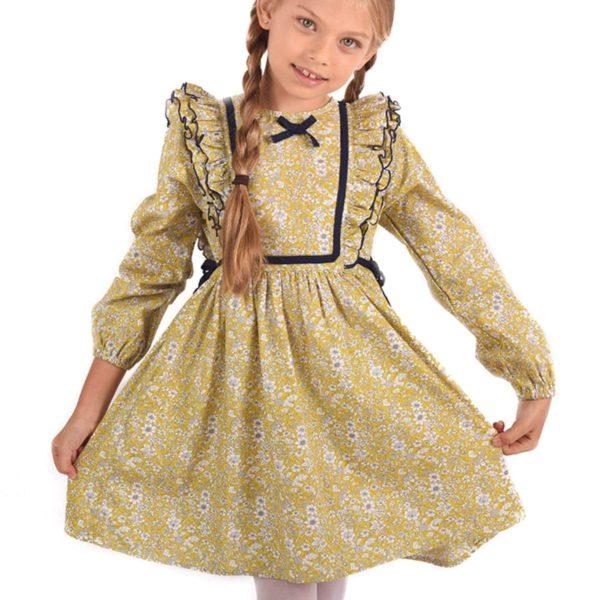 robe liberty fleurie jaune et bleu ciel, volants aux emmanchures, à manches longues avec élastique aux poignets et détails bleu marine. Marque mode enfant LA FAUTE A VOLTAIRE
